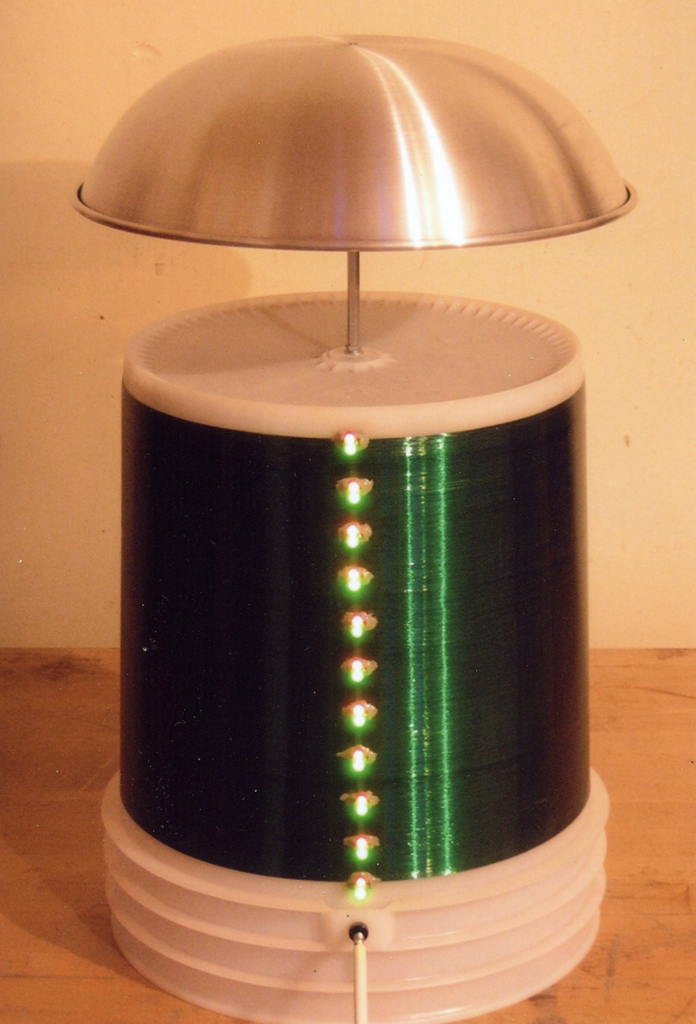 1992 Tesla coil resonator with LEDs to indicate current
